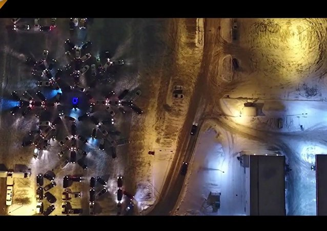 Winter Flashmob: 130 Rides Form A Giant Snowflake in Tver, Russia