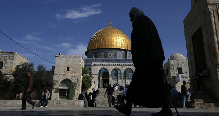 A Palestinian man walks past the Dome of Rock at the Al-Aqsa Mosque compound after the Friday prayer in Jerusalem's Old City on November 11, 2016