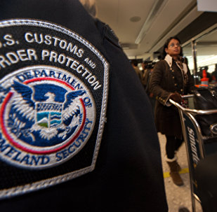 An international air traveler (r) clears US Customs and Border Protection declarations to enter the United States in the US Customs and Immigration area at Dulles International Airport(IAD) , December 21, 2011 in Sterling, Virgina, near Washington, DC