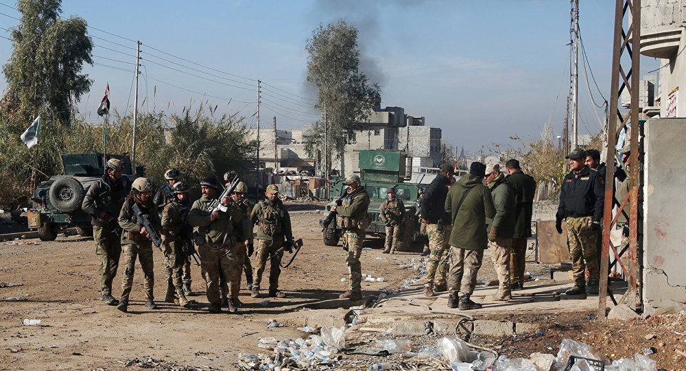 Iraqi rapid response forces gather during a fight with Islamic State militants in Intisar district of eastern Mosul, Iraq, December 22, 2016