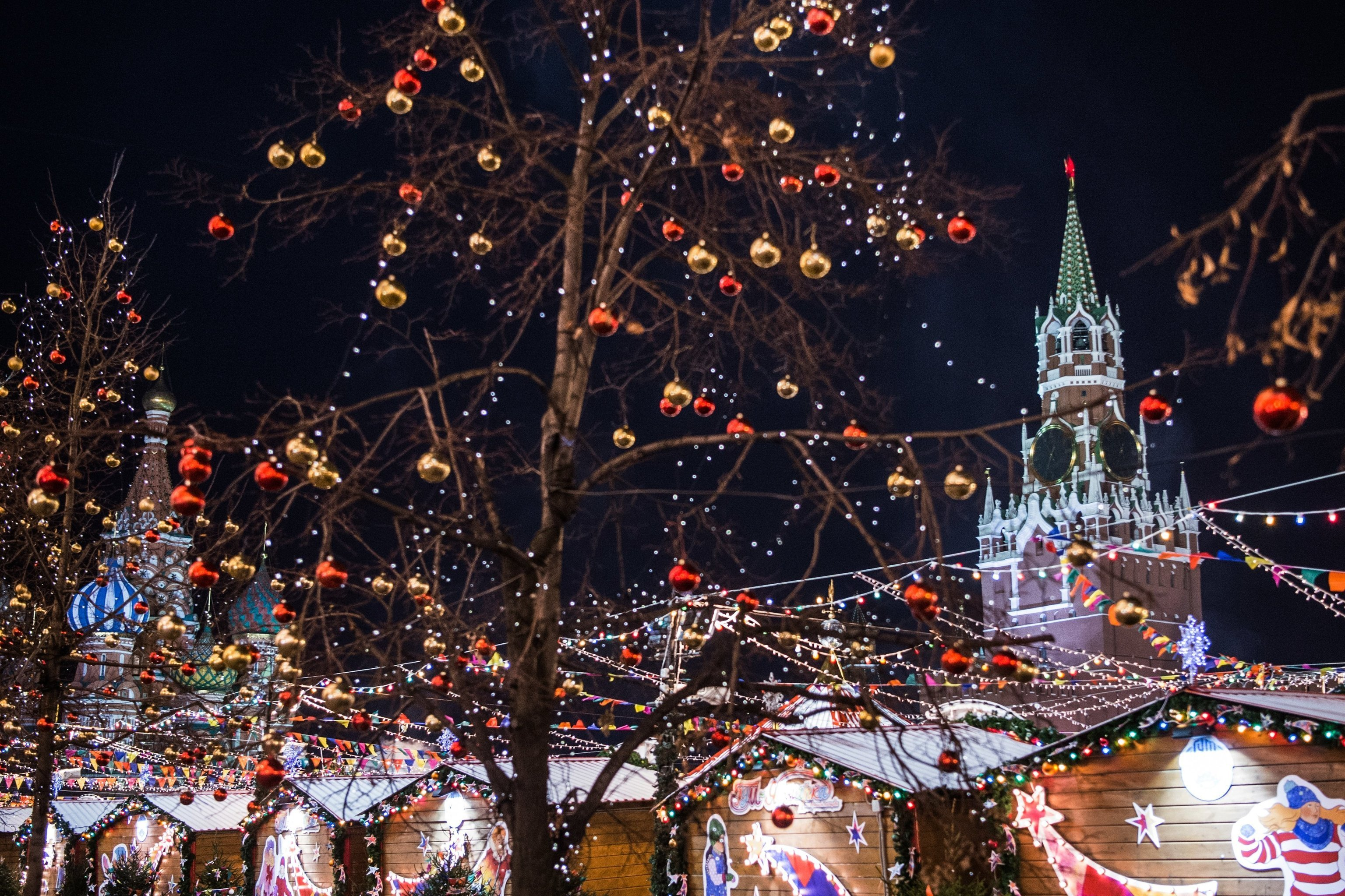 Festive illumination and the Spasskaya Tower of the Moscow Kremlin in Red Square