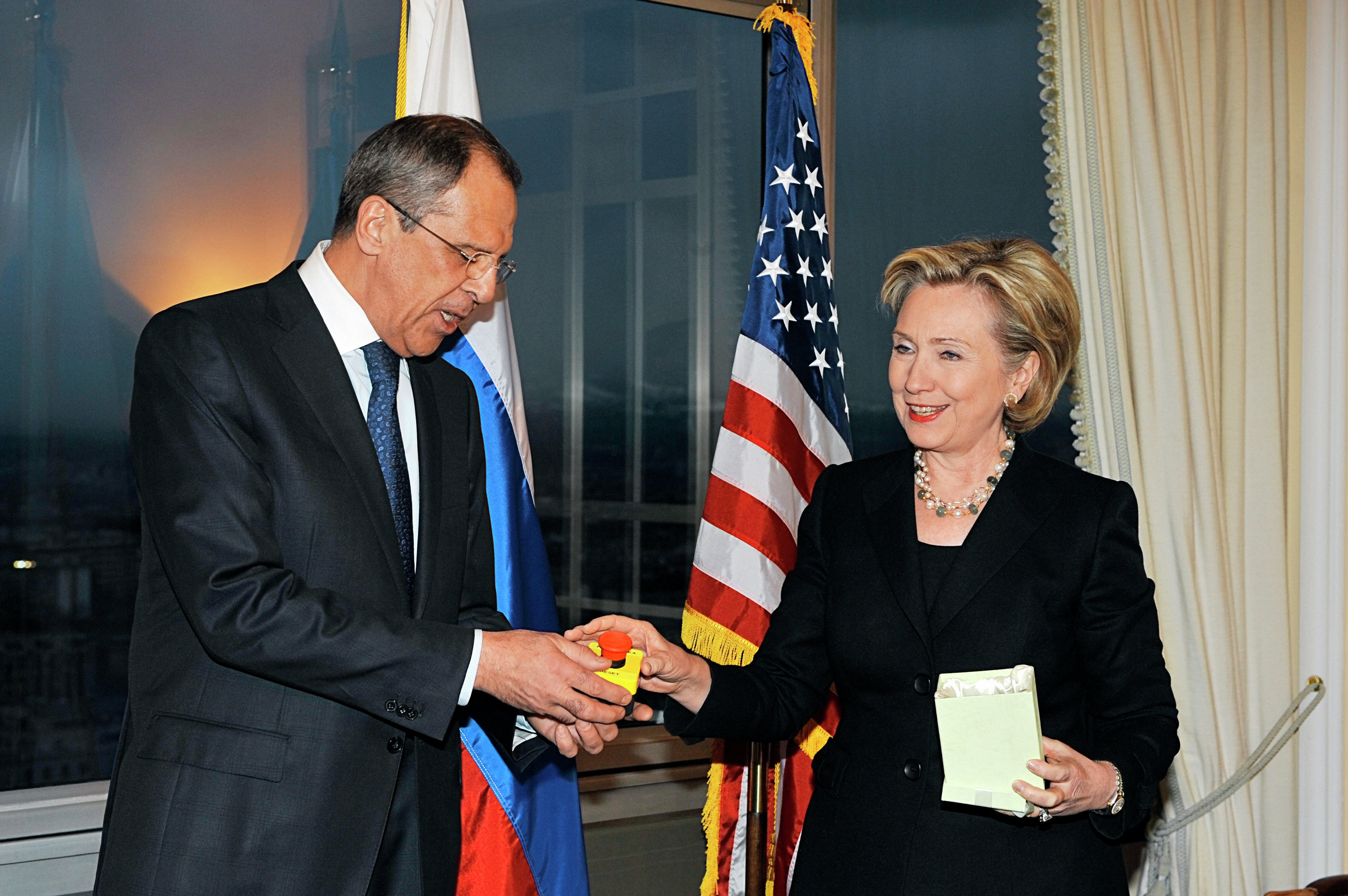 U.S. Secretary of State Hillary Clinton gives Russian Foreign Minister Sergei Lavrov the block with a red button marked reset in English and overload in Russian during a meeting in Geneva on March 6, 2009