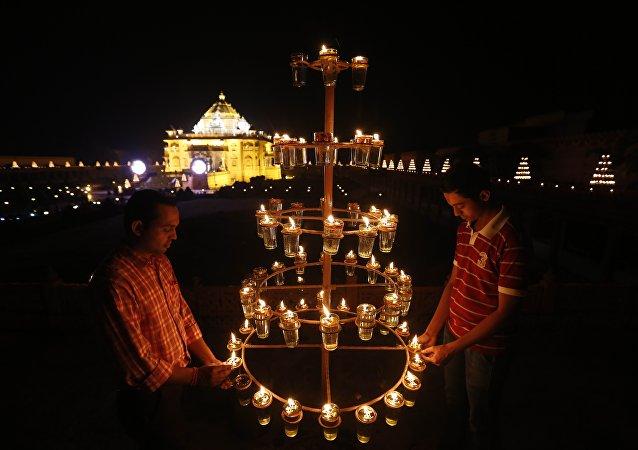 Indians light lamps at Akshardham temple on the eve of Diwali, the festival of lights, in Gandhinagar, India. (File)