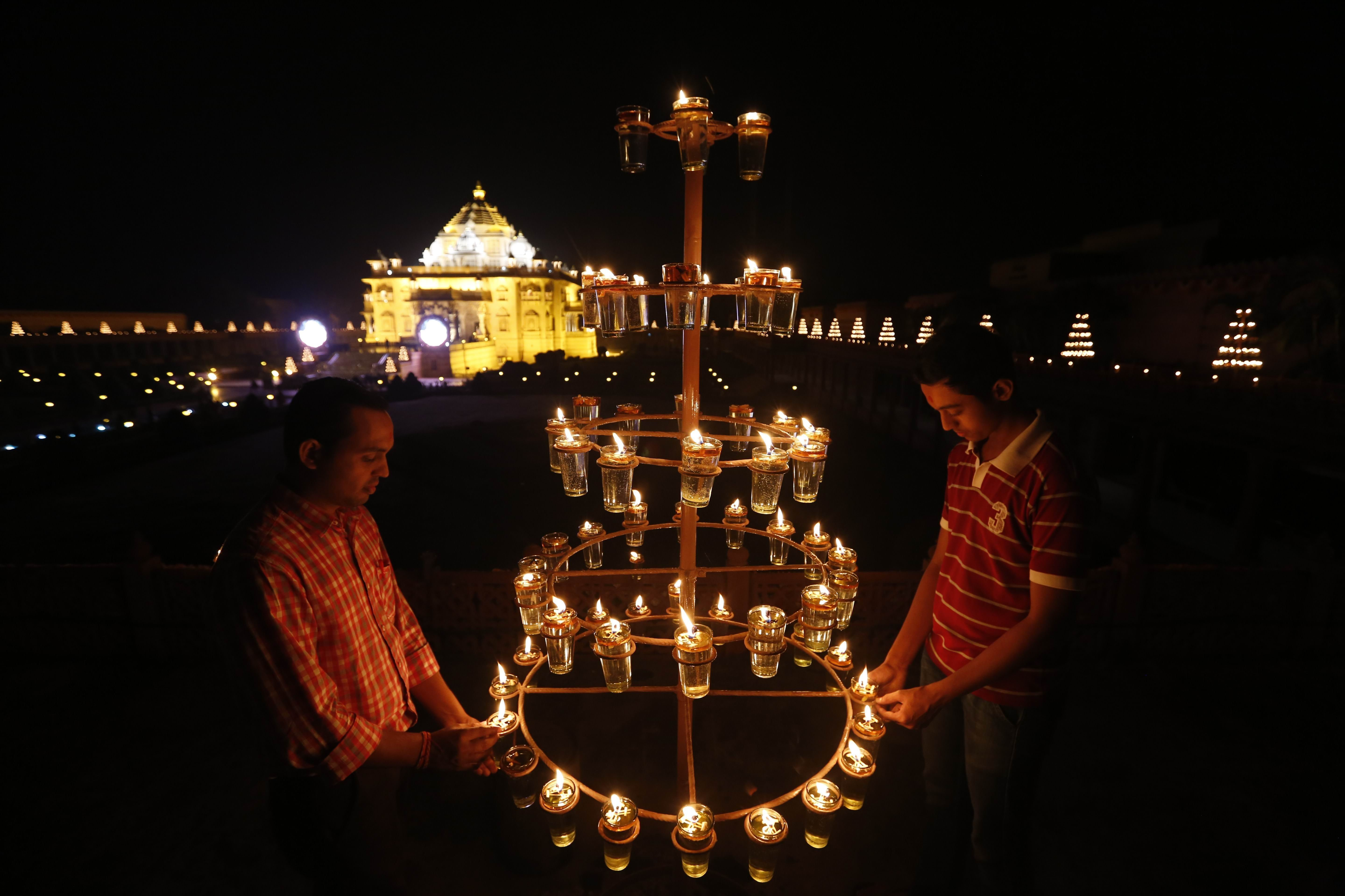 Indians Light Lamps At Akshardham Temple On The Eve Of Diwali, The Festival  Of Lights