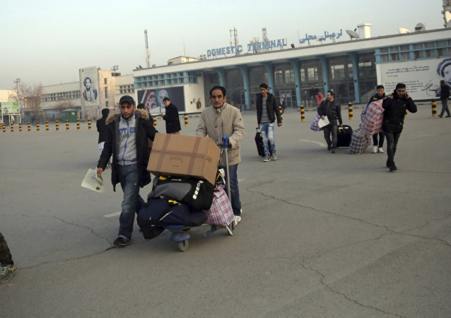 Afghans who were deported from Germany exit the Kabul International Airport, Kabul, Afghanistan, Thursday, Dec. 15, 2016