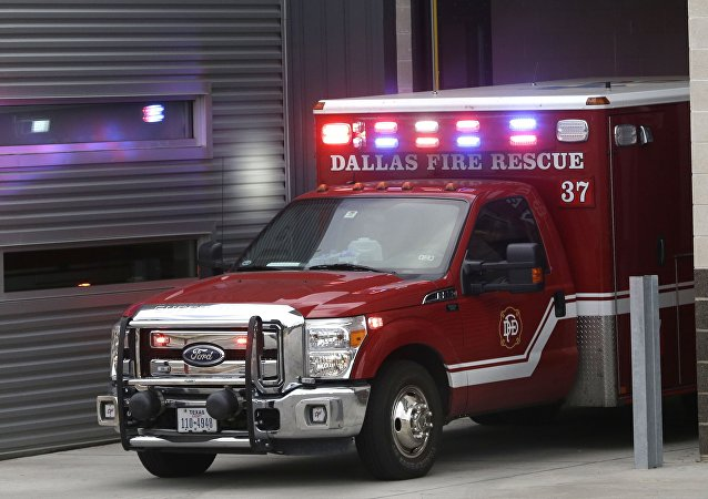 An ambulance pulls into the Dallas Fire-Rescue station 37 in Dallas, Wednesday, Oct. 1, 2014