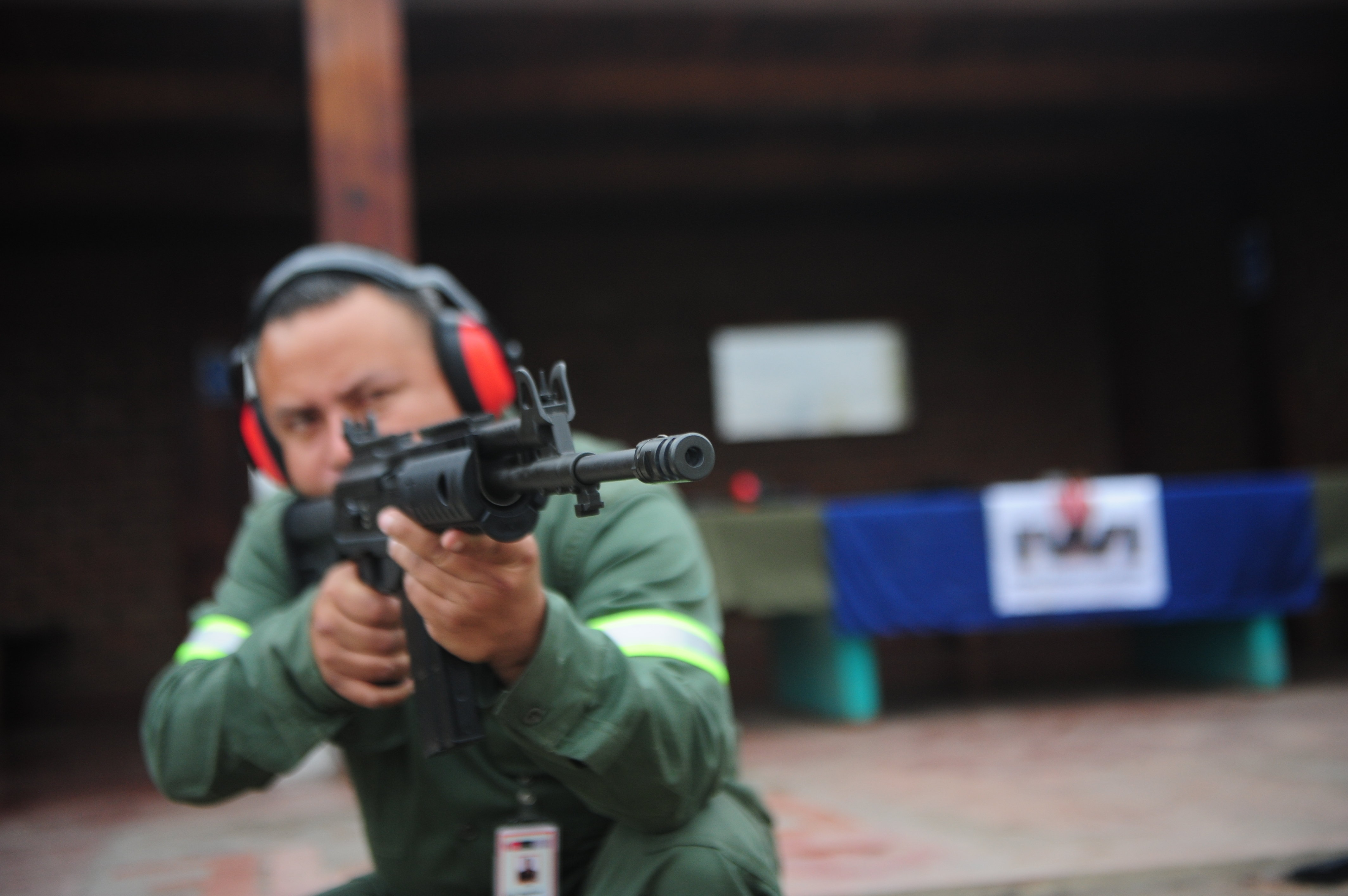 A soldier prepares to fire a Galil assault rifle at the FAME base (Army Factory of weapons and munitions of the Peruvian Army) in Lima on October 12, 2011