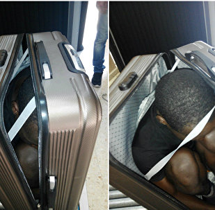 Photo released by the Spanish Guardia Civil on Tuesday, Jan. 3, 2017, a 19 year-old migrant from Gabon is photographed in a suitcase, in Ceuta, Spain.