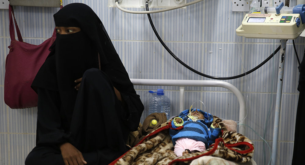 A woman sits next to her malnourished baby at a therapeutic feeding center in a hospital in Sanaa, Yemen. There have been numerous reported cases of dying from starvation in Yemeni hospitals.