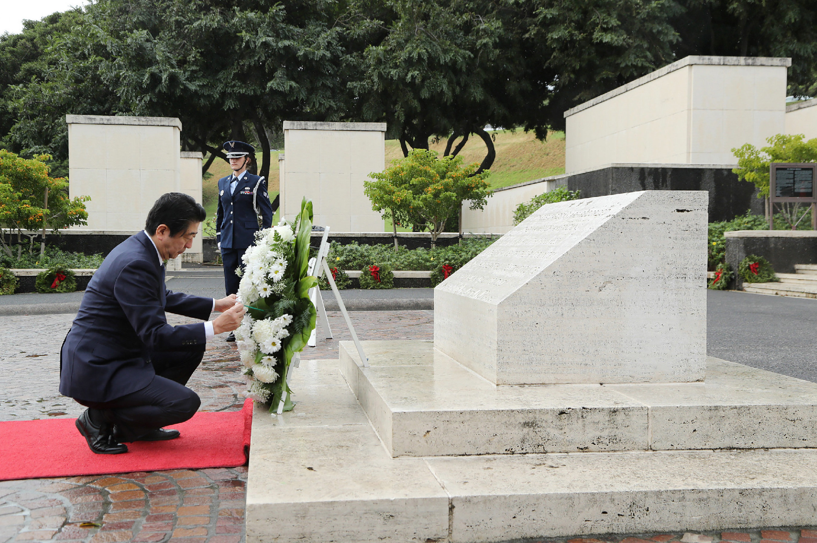 Japan's Prime Minister Shinzo Abe presents a wreath at the National Memorial Cemetery of the Pacific at Punchbowl in Honolulu, Hawaii, U.S. December 26, 2016