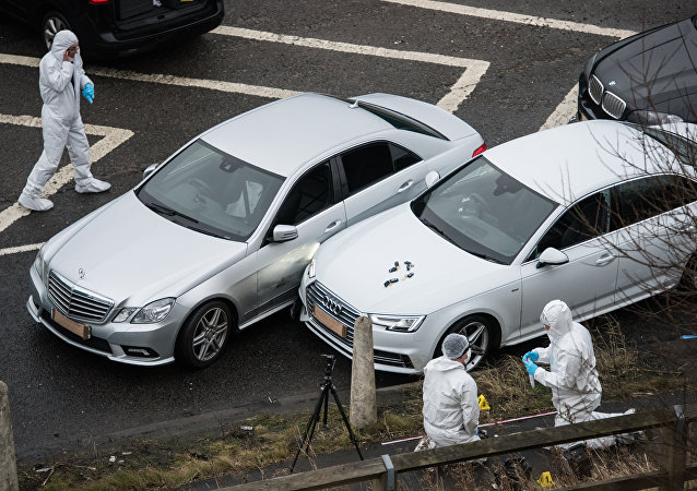 British police forensics officers inspect the scene of an incident, which resulted in a West Yorkshire police officer shooting a suspect in an Audi car, at the Ainley Top junction of the M62 motorway.