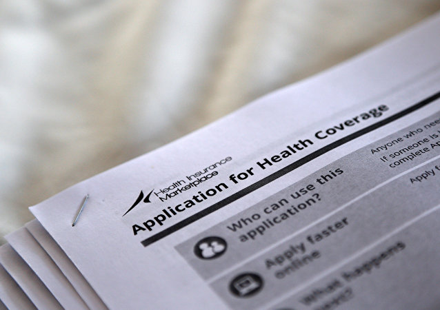 The federal government forms for applying for health coverage are seen at a rally held by supporters of the Affordable Care Act, widely referred to as Obamacare, outside the Jackson-Hinds Comprehensive Health Center in Jackson, Mississippi, U.S. (File)
