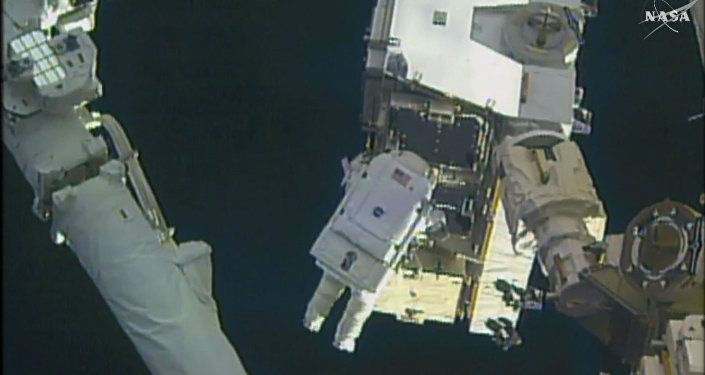 In this still image taken from video provided by NASA, astronaut Peggy Whitson takes a spacewalk outside the International Space Station on Friday, Jan. 6, 2016