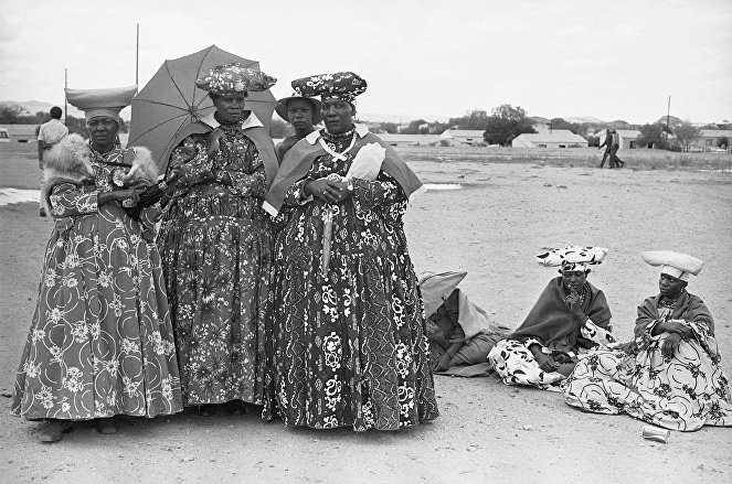 Herero women pose in their finery at a SWAPO rally held, January 1979 in Windhoek, Namibia.