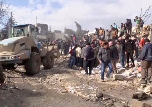 A still image taken from a video obtained by Reuters shows people and a bulldozer moving debris after a fuel truck exploded in the centre of rebel-held Azaz, near Syria's border with Turkey, January 7, 2017.
