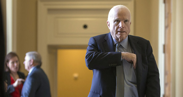 Senate Armed Services Committee Chairman John McCain, R-Ariz., leaves a closed-door GOP policy luncheon at the Capitol in Washington