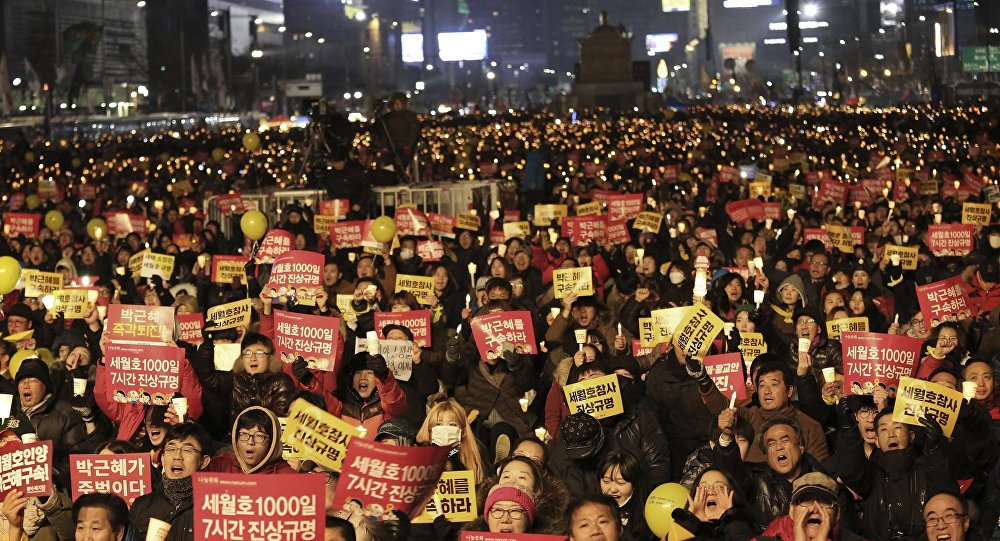 Protesters shout slogans during a candle light vigil calling for impeached President Park Geun-hye to step down in Seoul, South Korea