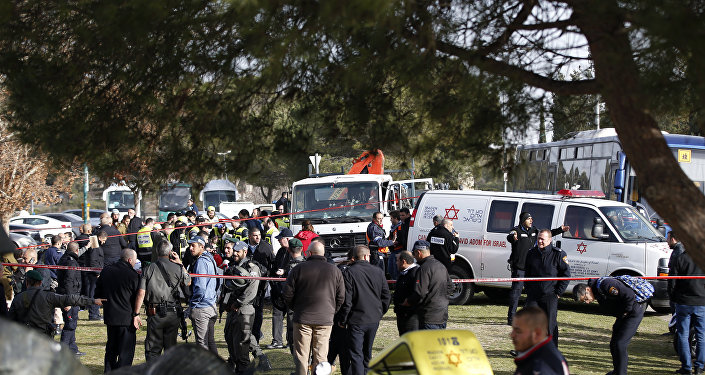 Israeli security forces and emergency personnel gather at the site of a vehicle-ramming attack in Jerusalem