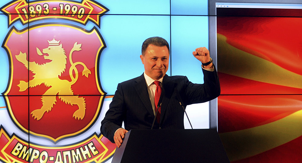 Nikola Gruevski, leader of the ruling conservative VMRO-DPMNE party, greets his supporters claiming victory on a general election, at the party headquarters in Skopje, Macedonia, early Monday, Dec. 12, 2016.