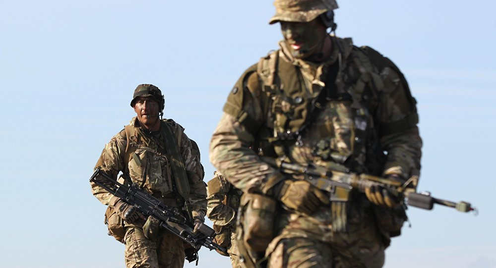 British soldiers scout a land zone during the 16 Air Assault Brigade Exercise Joint Warrior at West Freugh Airfield, Stranraer, Scotland on April 16, 2012.