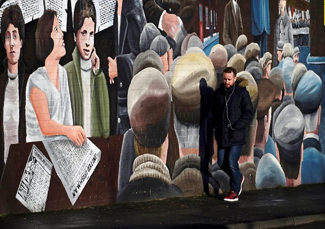 A man walks past a mural on the Falls Road a day after Northern Ireland's Deputy First Minister Martin McGuinness resigned, throwing the devolved joint administration into crisis, in Belfast Northern Ireland, January 10, 2017.