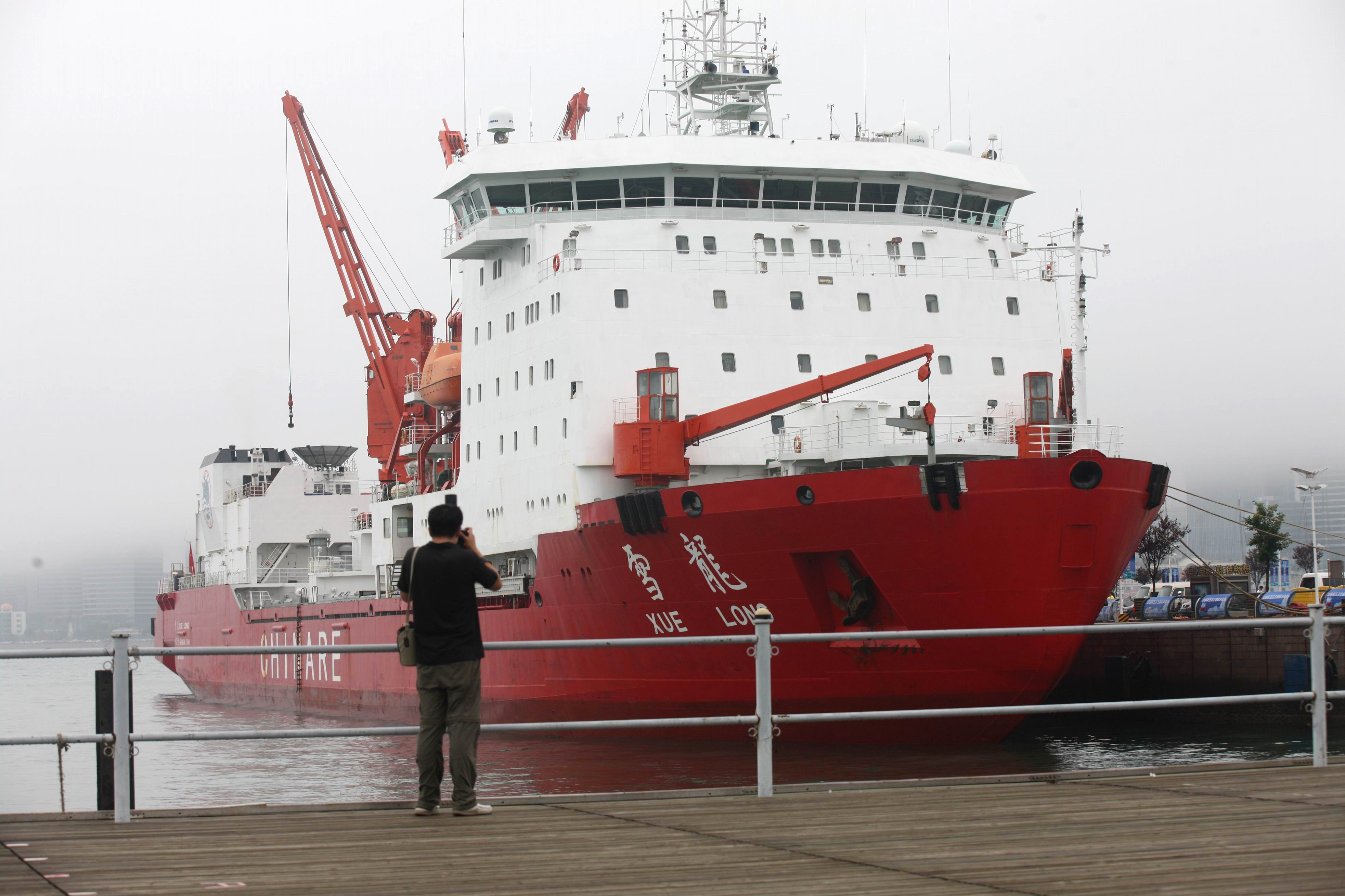 Man taking a photo of Chinese icebreaker Xuelong, literally snow dragon (File)