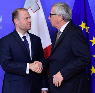 Malta's Prime Minister Joseph Muscat (L) is welcomed by European Commission President Jean-Claude Juncker prior to their meeting at the European Commission in Brussels, on November 16, 2016.