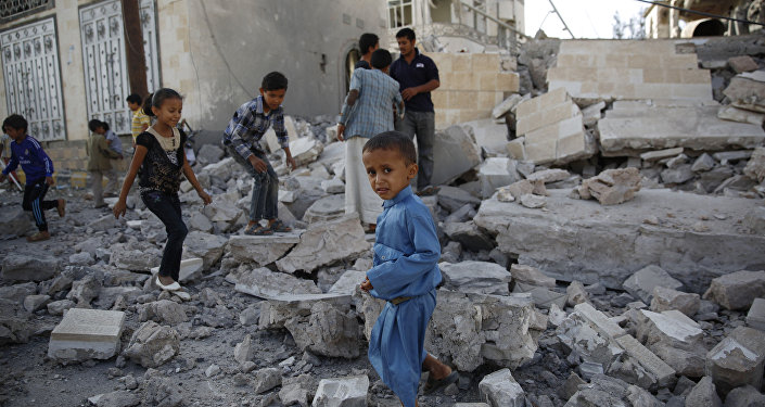In this Sept. 8, 2015 file photo, children play amid the rubble of a house destroyed by a Saudi-led airstrike in Sanaa, Yemen
