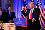 Vice President-elect Mike Pence is seen in the background as U.S. President-elect Donald Trump speaks during a press conference in Trump Tower, Manhattan, New York, U.S., January 11, 2017