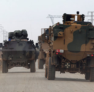 Turkish military vehicles drive in the Syrian rebel-held town of al-Rai, as they head towards the northern Syrian town of al-Bab, Syria January 4, 2017