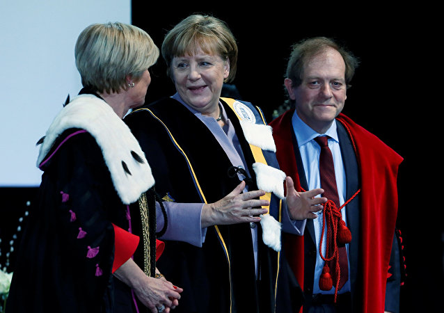 German Chancellor Angela Merkel (C) talks to Rector Anne De Paepe (L) of Belgian UGent university during a ceremony to receive a degree Honoris Causa, or honorary doctorate from the Belgian universities of KU Leuven and UGent in Brussels, Belgium January 12, 2017.