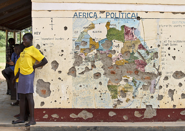 Students line up outside a classroom with a map of Africa on its wall, in Yei, in southern South Sudan (File)