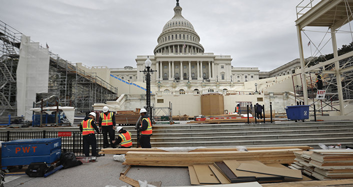 Construction continues on the Inaugural platform in preparation for the Inauguration and swearing-in ceremonies for President-elect Donald Trump, Thursday, Dec. 8, 2016, on the Capitol steps in Washington