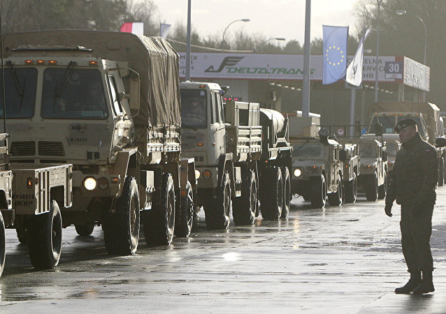 U.S. Army vehicles cross the Polish border in Olszyna, Poland, Thursday, Jan. 12, 2017 heading for their new base in Zagan