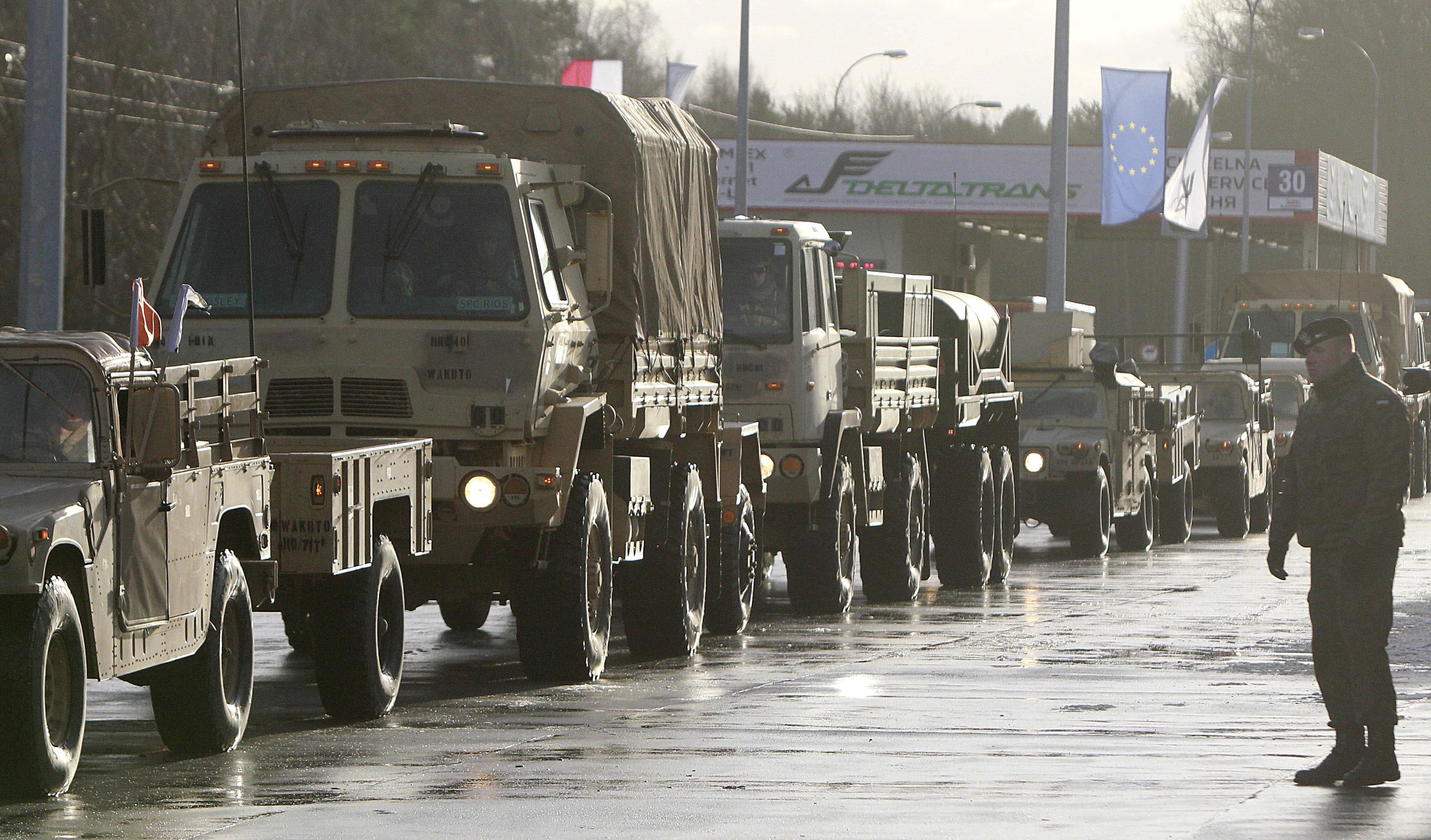 U.S. Army vehicles cross the Polish border in Olszyna, Poland, Thursday, Jan. 12, 2017 heading for their new base in Zagan