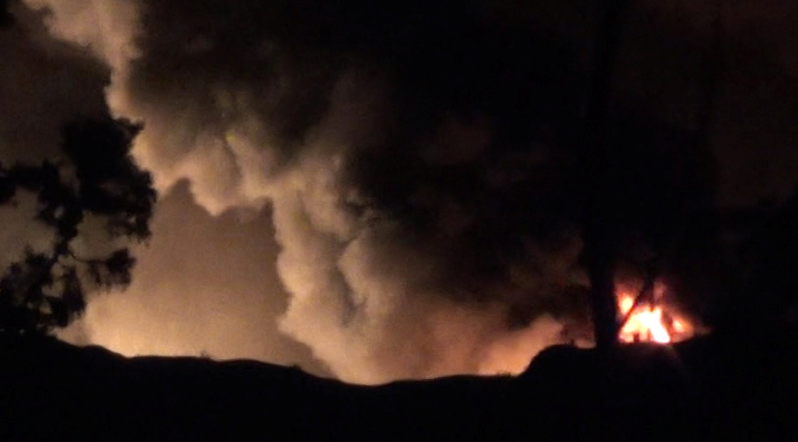 Smoke and flames are seen near Mezzah military airport, near Damascus, Syria, in this still image from video obtained by Reuters January 13, 2017