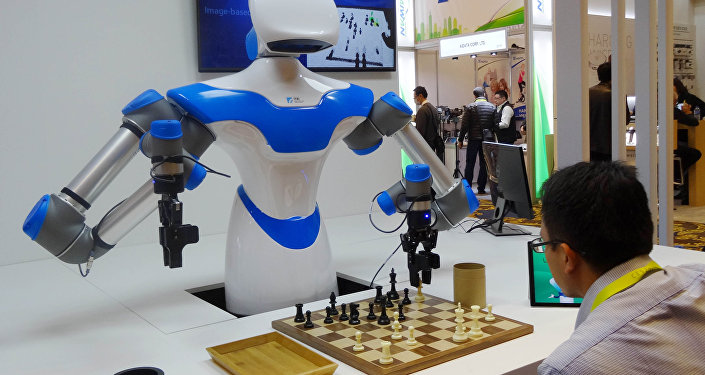 A robot developed by Taiwan engineers moves chess pieces on a board against an opponent, ,at the 2017 Consumer Electronic Show (CES) in Las Vegas, Nevada