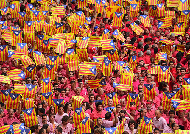 People showing 'Esteladas' (pro-independence Catalan flags) during the XXVI human towers, or 'castells', competetion in Tarragona on October 2, 2016.