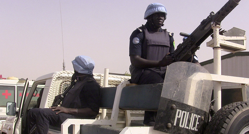 Malian police patrol with German UN mission in Mali (MINUSMA) peacekeping forces on May 18, 2016 in Gao, northern mali