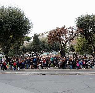 Students stand outdoors after being evacuated from their school following an earthquake in Rome, Italy, January 18, 2017.