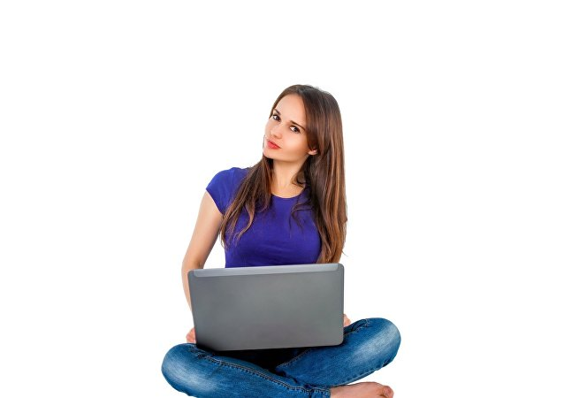 A teenage girl using a laptop