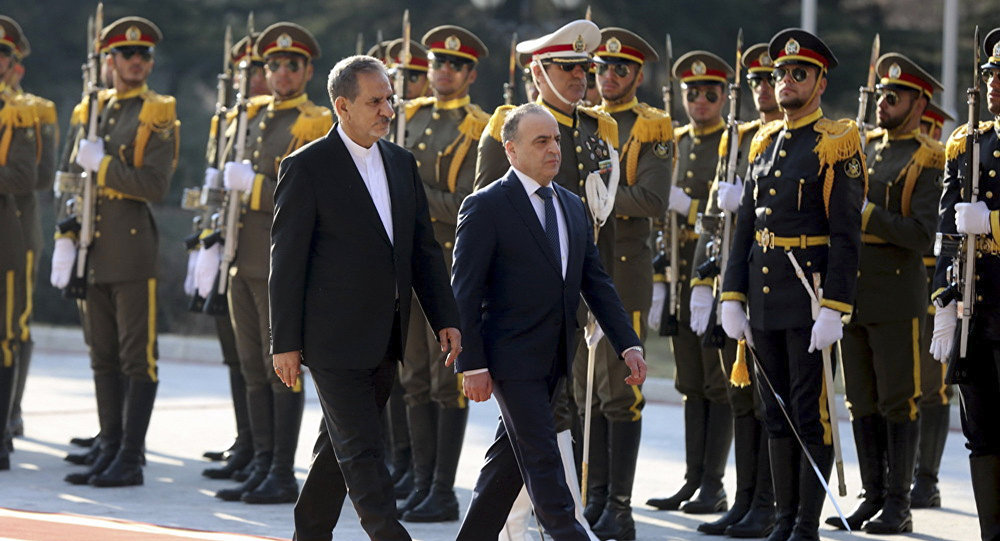In this photo released by official website of the office of the Iranian Senior Vice-President, Syrian Prime Minister Imad Khamis, right, reviews honor guard as he is accompanied by Iranian Senior Vice-President Eshagh Jahangiri, during his official welcoming ceremony in Saadabad palace in Tehran, Iran, Tuesday, Jan. 17, 2017