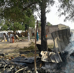 In this image supplied by MSF, smoke rises from a burnt out shelter at a camp for displaced people in Rann, Nigeria, Tuesday Jan. 17, 2017
