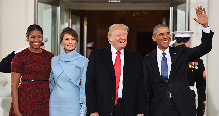 Barack Obama(R) and Michelle Obama(L) welcome Donald Trump(2nd-R) and his wife Melania to the White House in Washington, DC January 20, 2017