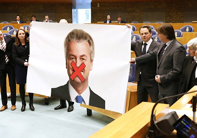 Members of right-wing Dutch Party for Freedom (Partij voor de Vrijheid - PVV) protest against the sentence demanded for their leader Geert Wilders with a large poster of Wilders displayed with a red cross over his mouth, in the Senate (Tweede Kamer) at the Binnenhof in The Hague