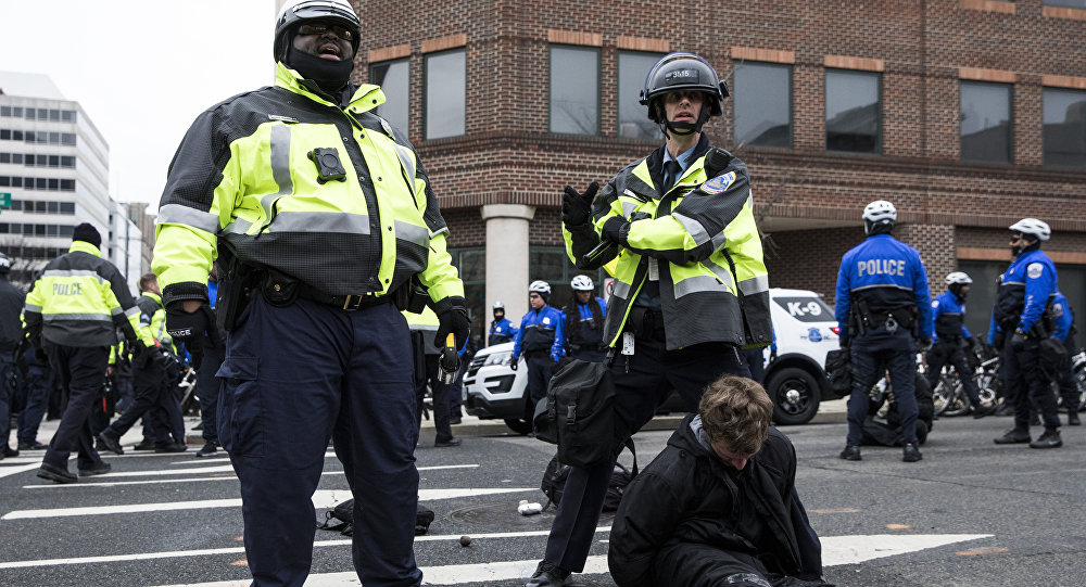 Police officers detain a demonstrator before the inauguration of President-elect Donald Trump January 20, 2017 in Washington, DC.