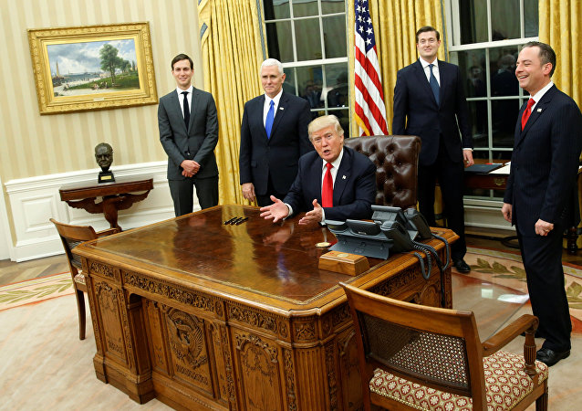 US President Donald Trump, flanked by Senior Advisor Jared Kushner (standing, L-R), Vice President Mike Pence, Staff Secretary Rob Porter and Chief of Staff Reince Priebus, welcomes reporters into the Oval Office for him to sign his first executive orders at the White House in Washington, US January 20, 2017.