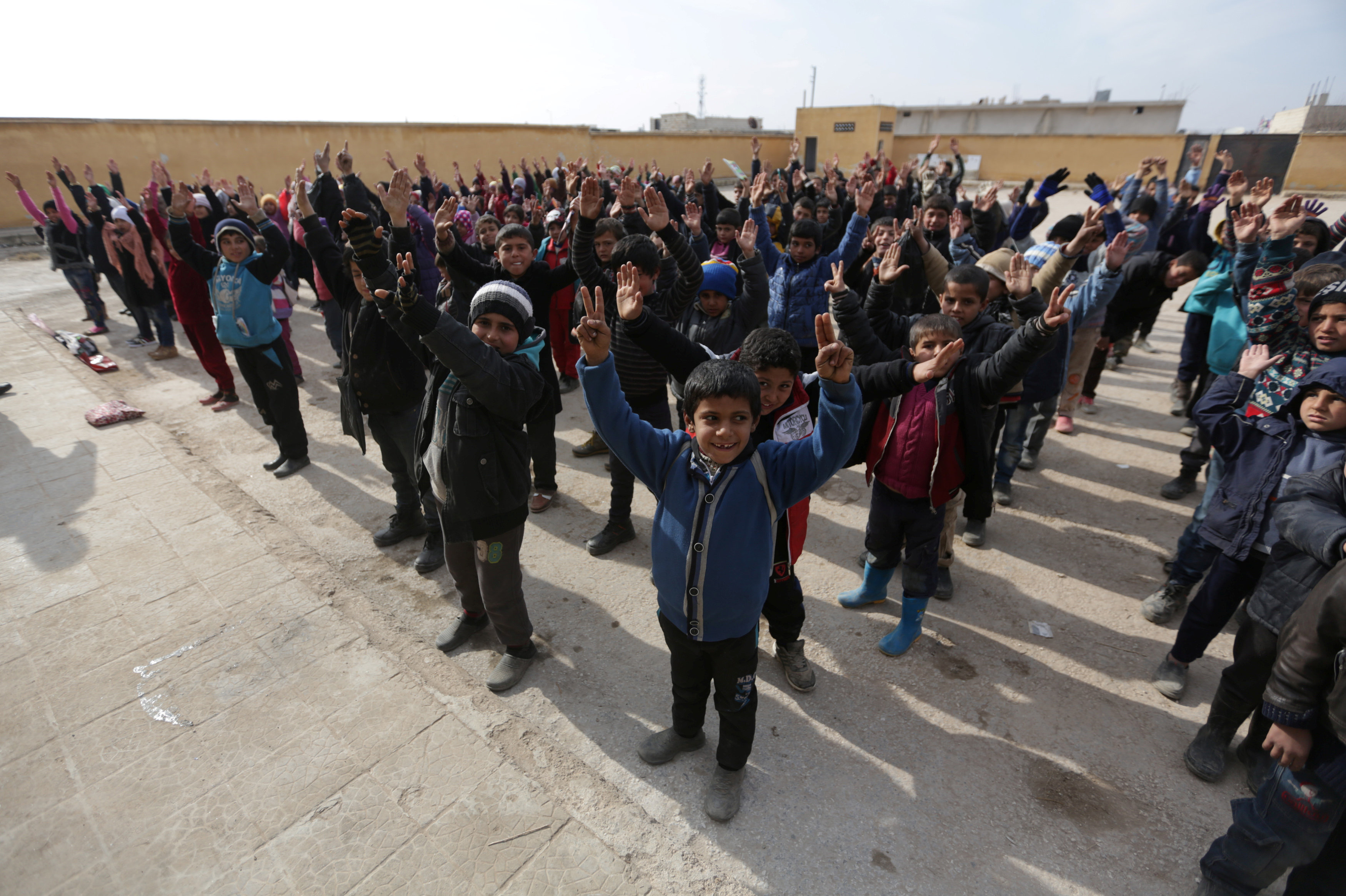 Students gesture as they stand in line at the 'Aisha Mother of the BelieversÕ school which was recently reopened after rebels took control of al-Rai town from Islamic State militants, Syria January 16, 2017