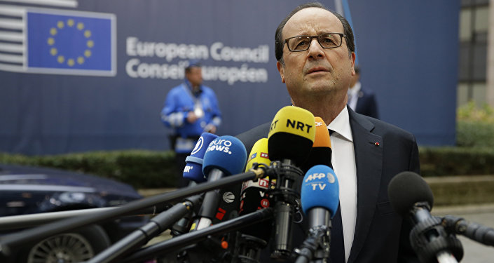 French President Francois Hollande speaks to media reporters as he arrives for the EU summit in Brussels, Thursday, Oct. 20, 2016.