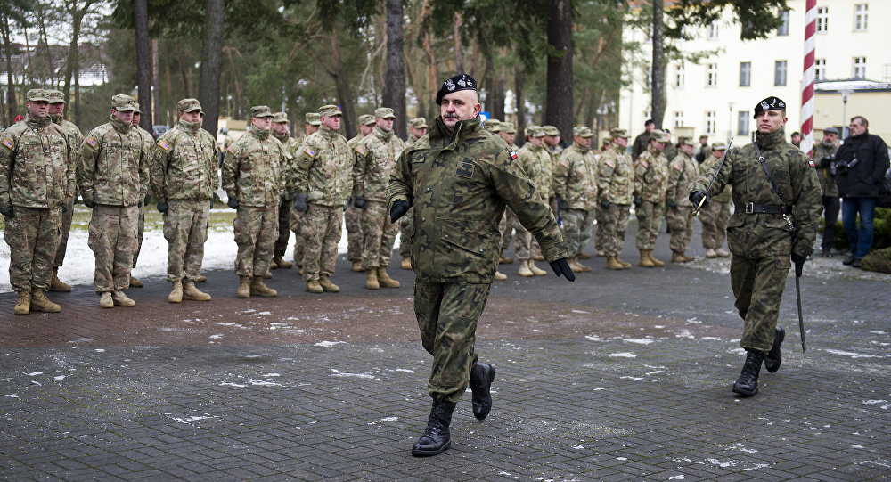 General Jaroslaw Mika marching before US soldiers during the welcome ceremony at the Polish military base in Zagan, Poland on January 12, 2017